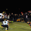 CARL RUSSO/Staff photo. Andover defeated North Andover 33-32 in overtime football action Friday night. North Andover's Tyler Salois dives as he attempts to block this field goal by Andover's Ryan Payne. He was unsuccessful. 9/6/2013.