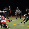 """CARL RUSSO/Staff photo. Andover's Christopher Nicholas makes a good but unsuccessful attempt to block the extra point by Central Catholic's Paul Karamourtopoulos after Central scored its first touchdown of the game. Central defeated Andover 26-7 in Friday night football action. FOR MORE PHOTOS GO TO  <a href=""""http://smu.gs/19G3xGH"""">http://smu.gs/19G3xGH</a>. 9/27/2013."""