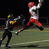 """CARL RUSSO/Staff photo. Central Catholic's captain, D'Andre Drummond-Mayrie leaps into the air and intercepts the pass intended for Andover's Brandon Marti near the end zone. Central defeated Andover 26-7 in Friday night football action. FOR MORE PHOTOS GO TO  <a href=""""http://smu.gs/19G3xGH"""">http://smu.gs/19G3xGH</a>. 9/27/2013."""