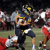 """CARL RUSSO/Staff photo. Andover's quarterback, Oliver Eberth maneuvers around Central Catholic defenders as they try to tackle him. Central defeated Andover 26-7 in Friday night football action. FOR MORE PHOTOS GO TO  <a href=""""http://smu.gs/19G3xGH"""">http://smu.gs/19G3xGH</a>. 9/27/2013."""