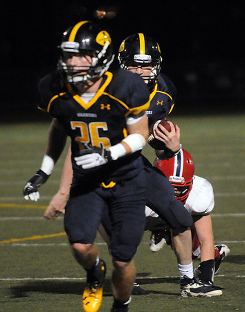 """CARL RUSSO/Staff photo. Andover's captain, Jack Sylvester leads the way as quarterback, E. J. Perry runs the ball. Central defeated Andover 26-7 in Friday night football action. FOR MORE PHOTOS GO TO  <a href=""""http://smu.gs/19G3xGH"""">http://smu.gs/19G3xGH</a>. 9/27/2013."""