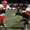 """CARL RUSSO/Staff photo. Central Catholic's captain, D'Andre Drummond-Mayrie sprints for the sideline as Andover's Max Grant moves in and forces him out of bounds. Central defeated Andover 26-7 in Friday night football action. FOR MORE PHOTOS GO TO  <a href=""""http://smu.gs/19G3xGH"""">http://smu.gs/19G3xGH</a>. 9/27/2013."""