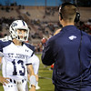 TIM JEAN/Staff photo. St. John's Prep quarterback Michael Gleaslen talks with his coach during a football game against Central Catholic High School. 9/20/13