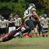 CARL RUSSO/Staff photo. Whittier Tech.'s Scott Bonneau dives towards Northeast Tech.'s Christian Perez (23) knocking him off balance and making the tackle in football action. Whittier was defeated by Northeast 18-14 in Saturday game action. 10/5/2013.