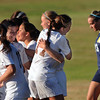 CARL RUSSO/Staff photo. Haverhill's Grace Stanton (center) is congratulated by teammate, Molly Thomas (17) after scoring a goal at the start of the second half to give Haverhill the 2-1 lead. Stanton would score again later in the game to give the Hillies the 3-1 victory in Tuesday afternoon soccer action. 10/1/2013.