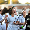 CARL RUSSO/Staff photo. The Haverhill Hillies celebrate their 3-1 victory against Andover with their goalkeeper, Marlayna Buco (left)  in Tuesday afternoon soccer action. 10/1/2013.