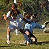 CARL RUSSO/Staff photo. Andover's goalie, Emily Wilson makes the save on a break away by Haverhill's Kerrin Thomas in second half soccer action. Haverhill defeated Andover 3-1. 10/1/2013.