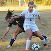 CARL RUSSO/Staff photo. Haverhill's Ashley Onofaro (4) battles for the ball with Andover's Meredith Van Antwerp in Tuesday afternoon soccer action. Haverhill defeated Andover 3-1. 10/1/2013.