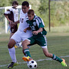 MARY SCHWALM/Staff photo  Haverhill's Andy Segura challenges a Billerica player during their soccer game at Haverhill High School. 9/5/13