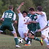 MARY SCHWALM/Staff photo  Haverhill's Alejandro Lopez (4) lunges for a ball against the Billerica defense during their soccer game at Haverhill High School. 9/5/13