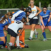 CARL RUSSO/Staff photo. Andover defeated Methuen 5-0 in field hockey action Monday afternoon. Methuen's goalie, Juliana Zingales makes the save against Andover's captain, Christine Aumais, 8, with the help of her teammate, Megan Bruneau, 25.  9/9/2013.