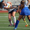 CARL RUSSO/Staff photo. Andover defeated Methuen 5-0 in field hockey action Monday afternoon. Methuen's Lauren McDonough, right, battles for the ball with Andover's captain, Weezie Gross. 9/9/2013.