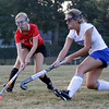 MARY SCHWALM/Staff photo  North Andover's Anna Bennett, left, and Methuen's Chase Lees battle for the ball during their field hockey game in Methuen. 9/11/13