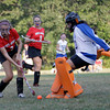MARY SCHWALM/Staff photo  Methuen goalie Julieanna Zingales makes a save on shot attempt by North Andover's Olivia Moen duirng their field hockey game in Methuen. 9/11/13