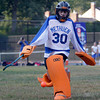 MARY SCHWALM/Staff photo  Juliana Zingales makes a kick save during a field hockey game against North Andover. 9/11/13