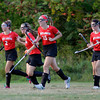MARY SCHWALM/Staff photo North Andover's Morgan Coakley, second left, is congratulated by teammates after scoring a goal in their field hockey game against Methuen in Methuen.  9/11/13