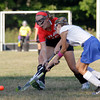 MARY SCHWALM/Staff photo  North Andover's Emma Johns, left, and Methuen's Katrina Crowe vie for a loose ball during their field hockey game in Methuen. 9/11/13