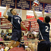 Lawrence's Janci Soto (4) leaps to spike the ball from the set of Andy Henriquez.