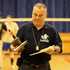 Lawrence head volleyball coach Tony Hajjar holds the second place trophy after his team lost to Acton-Boxboro in the Division 1 North Final.
