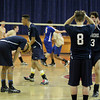 Lawrence players react after losing the fifth set, 15-13 to Acton-Boxboro.