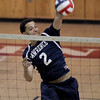Lawrence's Andy Henriquez spikes the ball uncontested at the net during their match against Acton-Boxboro.
