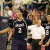 Lawrence's Andy Henriquez (2) reacts to a call as Kevin Vanderhorst (38) looks on.