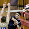 Lawrence's Tyler Cerullo spikes the ball past the Acton-Boxboro defense.