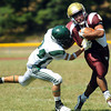 CARL RUSSO/Staff photo. Whittier Tech. was defeated by Austin Prep 22 to 14 in Saturday morning football action. Whittier's Jesus Sanchez, right fights to break the tackle by Austin Prep's Christos Kourkoulos. 9/7/2013.