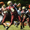 CARL RUSSO/Staff photo. Whittier Tech. was defeated by Austin Prep 22 to 14 in Saturday morning football action. Whittier's quarterback, Connor Bradley looks to pass long. 9/7/2013.