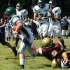CARL RUSSO/Staff photo. Whittier Tech. was defeated by Austin Prep 22 to 14 in Saturday morning football action. Whittier's Xabvier Gomez tries to hold onto Austin Prep's Nicholas Mulcahy after his teammate Scott Bonneau, far right fails to make the tackle. 9/7/2013.