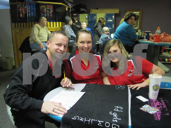 Assistant Dodger coach Mericle, Allison Birnbaum, and Ciara Sturm at the Dodger bowling meet at Ridgewood Lanes.
