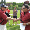 Fitchburg High School Athletic Director Ray Cosenza, right, congratulates coach Chris Woods on his decades of service to local athletes.