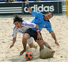 France's Sebastien Perez, left, fights for the ball with<br /> Parrillo from Uruguay during the FIFA Beach Soccer World Cup final match in Rio de Janeiro, Brazil, Nov. 11, 2007. Uruguay won 1-0 after penalty shoot-out. (Australfoto/Renzo Gostoli)
