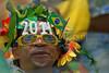 A Brazilian beach soccer fan wears a pair of sunglasses announcing the FIFA Football World Cup 2014 in Brazil, during the FIFA Beach Soccer World Cup final match in Rio de Janeiro, Brazil, Nov. 11, 2007. Brazil won 8-2 and got the trophy. (Australfoto/Renzo Gostoli)