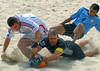 France's Gregory Tanagro, left, fights for the ball with<br /> Uruguaian goalkeeper Diego and Coco (4) from Uruguay, right during the FIFA Beach Soccer World Cup final match in Rio de Janeiro, Brazil, Nov. 11, 2007. Uruguay won 1-0 after penalty shoot-out. (FOTO:AUSTRAL FOTO/RENZO GOSTOLI)