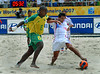 Brazil's Junior Negao, left, fights for the ball with Thierry Ottavy, right, from France during the FIFA Beach Soccer World Cup semi-final match in Rio de Janeiro, Brazil, Nov. 10, 2007. Brazil won  6-2. (Australfoto/Renzo Gostoli)