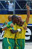 Brazil's Buru (11), right, celebrates with tema-mates Junior Negao, center and Sidney, back, a goal against France team during the FIFA Beach Soccer World Cup semi-final match in Rio de Janeiro, Brazil, Nov. 10, 2007. Brazil won  6-2. (Australfoto/Renzo Gostoli)