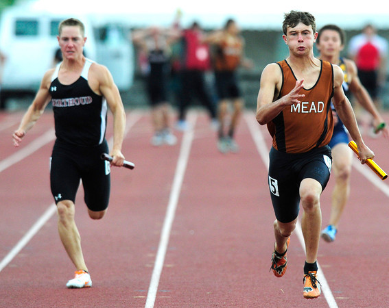 "Alex Mead of Mead, right,  runs the anchor leg  to a first place finish in the 3A boys 4x100 relay during the last day of the 2012 Colorado High School State Track & Field Championships at Jefferson County Stadium. Photo by Paul Aiken / The Boulder Camera / may 19 2012<br /> Photo more photos go to  <a href=""http://www.dailycamera.com"">http://www.dailycamera.com</a>"
