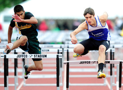 Matt Radich, right, of Lyons, at right runs to a first place finish in the 2A boys 110 hurdles during the last day of the 2012 Colorado High School State Track & Field Championships at Jefferson County Stadium. Photo by Paul Aiken / The Boulder Camera / may 19 2012 Photo more photos go to www.dailycamera.com