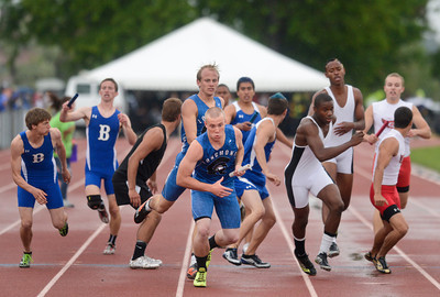Longmont's DJ Fowler takes the handoff from teammate Forrest Wetterstrom in the 4A Boys 4x400 meter relay during the last day of the 2012 Colorado High School State Track and Field Championships at Jefferson County Stadium on Saturday, May 19, 2012.  Longmont finished third in the race.  (Greg Lindstrom/Times-Call)