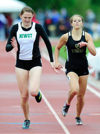 "Kelsey Traxinger, Niwot, at left  finished 8th in the 4A girls 400 run during the last day of the 2012 Colorado High School State Track & Field Championships at Jefferson County Stadium. Photo by Paul Aiken / The Boulder Camera / may 19 2012<br /> Photo more photos go to  <a href=""http://www.dailycamera.com"">http://www.dailycamera.com</a>"