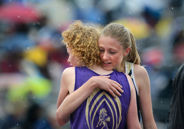 Nederland's Kelley Robinson, right, hugs West Grand's Tabor Scholl after the 2A girls 1600 meter run during the last day of the 2012 Colorado High School State Track and Field Championships at Jefferson County Stadium on Saturday, May 19, 2012. Scholl and Robinson finished first and second, respectively.<br /> <br /> (Greg Lindstrom/Times-Call)