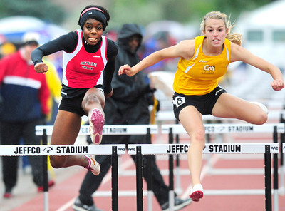 Deandra Elcock, left,  of Skyline runs to a 9th place finish in the 4A girls 100 hurdles during the last day of the 2012 Colorado High School State Track & Field Championships at Jefferson County Stadium. Photo by Paul Aiken / The Boulder Camera / may 19 2012 Photo more photos go to www.dailycamera.com