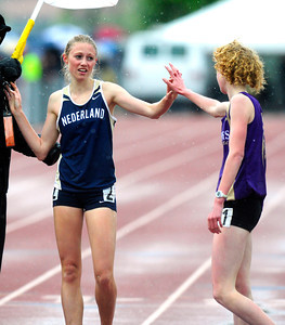 Kelley Robinson, of Nederland, at left, greets Tabor Scholl of West Grand the winner of the 2A girls 1,600 run during the last day of the 2012 Colorado High School State Track & Field Championships at Jefferson County Stadium. Robinson finished second. Photo by Paul Aiken / The Boulder Camera / may 19 2012 Photo more photos go to www.dailycamera.com