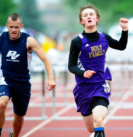 """Ryan Willis, left, of Holy Family runs to a second place finish in the 3A boys 110 hurdles, during the last day of the 2012 Colorado High School State Track & Field Championships at Jefferson County Stadium. Photo by Paul Aiken / The Boulder Camera / may 19 2012<br /> Photo more photos go to  <a href=""""http://www.dailycamera.com"""">http://www.dailycamera.com</a>"""