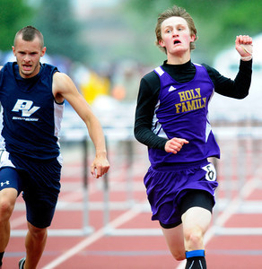 Ryan Willis, left, of Holy Family runs to a second place finish in the 3A boys 110 hurdles, during the last day of the 2012 Colorado High School State Track & Field Championships at Jefferson County Stadium. Photo by Paul Aiken / The Boulder Camera / may 19 2012 Photo more photos go to www.dailycamera.com