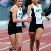 "Deyja Enriquez passes the baton to Dana Maydew of Niwot for a fourth place finish in the 4A girls 4x400 relay during the last day of the 2012 Colorado High School State Track & Field Championships at Jefferson County Stadium. Photo by Paul Aiken / The Boulder Camera / may 19 2012<br /> Photo more photos go to  <a href=""http://www.dailycamera.com"">http://www.dailycamera.com</a>"