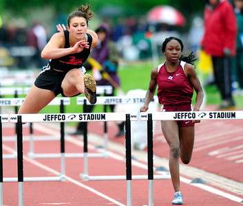 Justine Sherman, left,  of Fairview High School runs to a 7th place finish in the 5A girls 100 hurdles during the last day of the 2012 Colorado High School State Track & Field Championships at Jefferson County Stadium. Photo by Paul Aiken / The Boulder Camera / may 19 2012 Photo more photos go to www.dailycamera.com