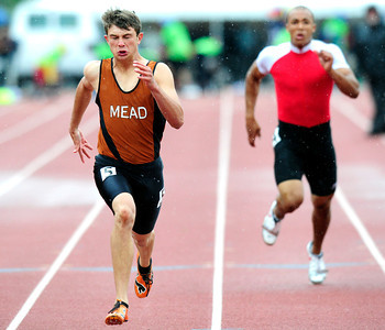 Alex Mead, left, of Mead runs to first place finish in the 3A boys 100 dash, during the last day of the 2012 Colorado High School State Track & Field Championships at Jefferson County Stadium. Photo by Paul Aiken / The Boulder Camera / may 19 2012 Photo more photos go to www.dailycamera.com