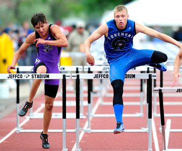 Josh Cogdill, right, of Longmont, runs to a 5th place finish in the 4A boys 110 hurdles during the last day of the 2012 Colorado High School State Track & Field Championships at Jefferson County Stadium. Photo by Paul Aiken / The Boulder Camera / may 19 2012 Photo more photos go to www.dailycamera.com